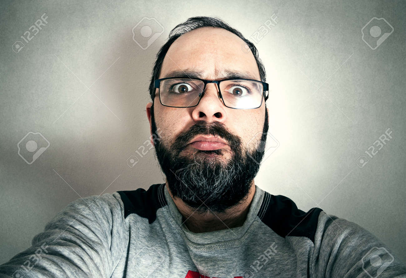 Funny man with the beard making expressions - 166803473