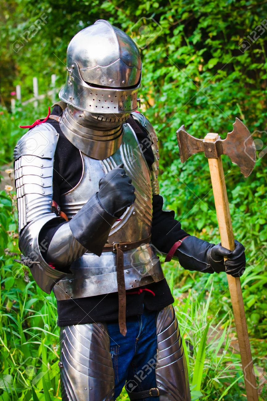 knight in shining armor on a green background Stock Photo - 7852458