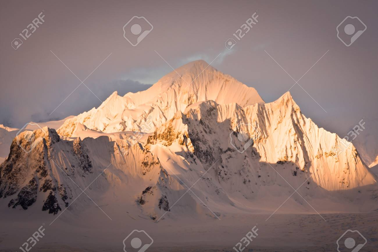 Beautiful snow-capped mountains against the sky Stock Photo - 8130670