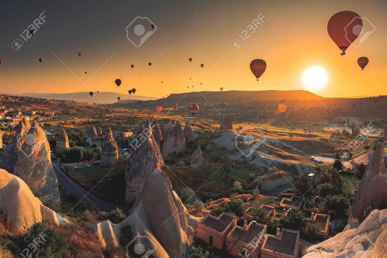 Hot air balloon flying over spectacular Cappadocia - 51472860