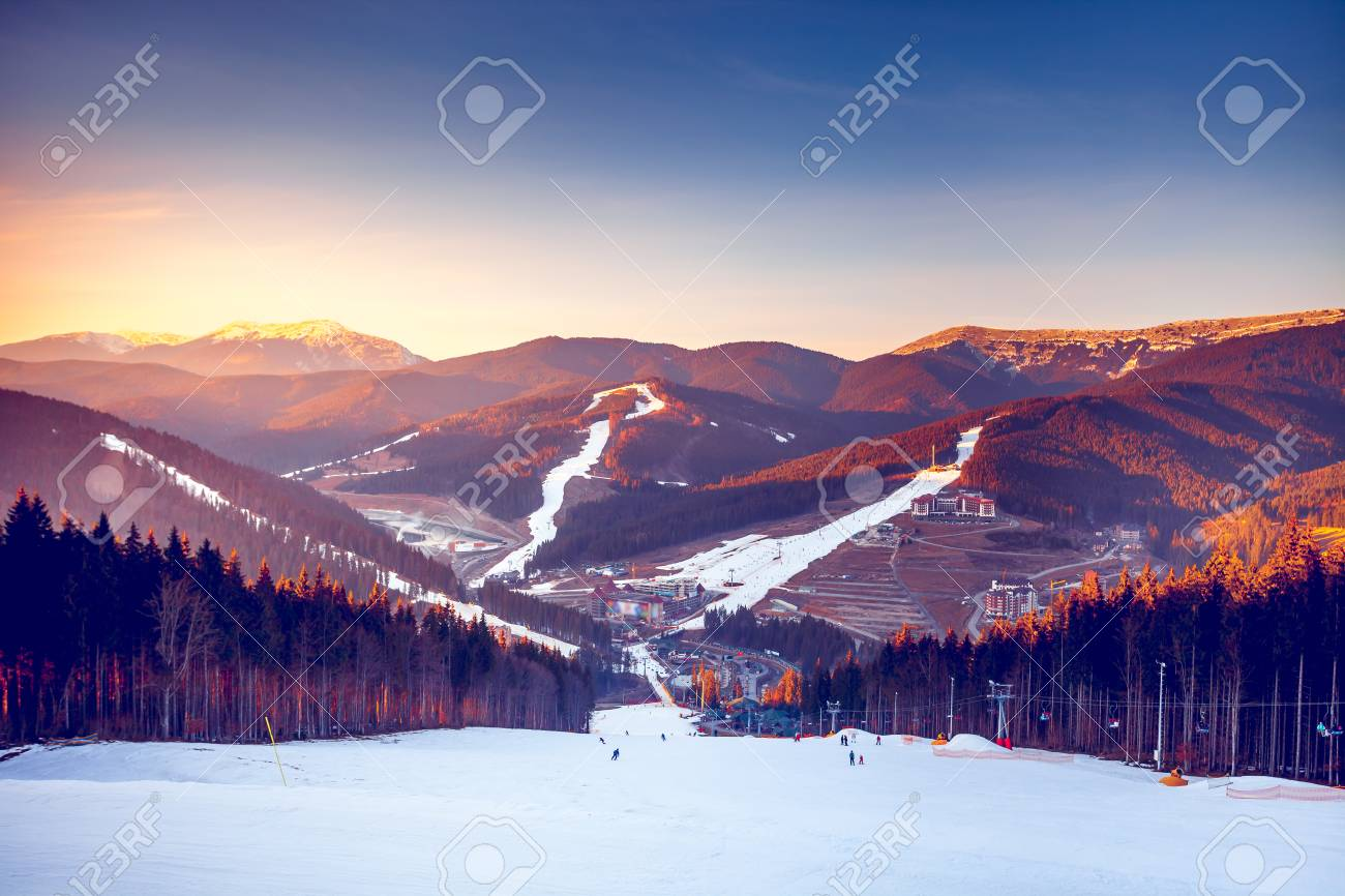 ski resort in beautiful sunset light. view from the top: ski.. stock