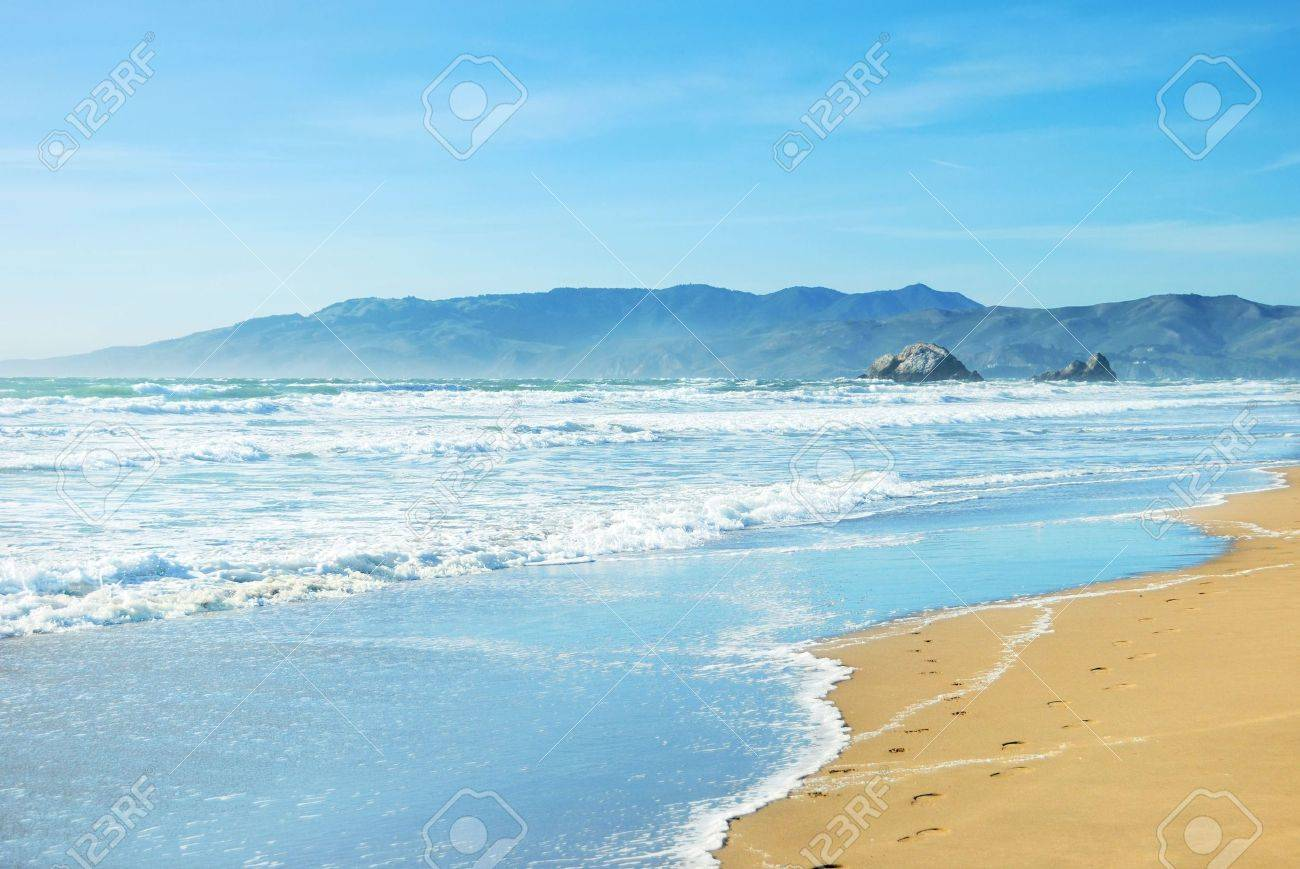Beach in San Francisco California with waves coming to the sand and blue sky background. Stock Photo - 4715548