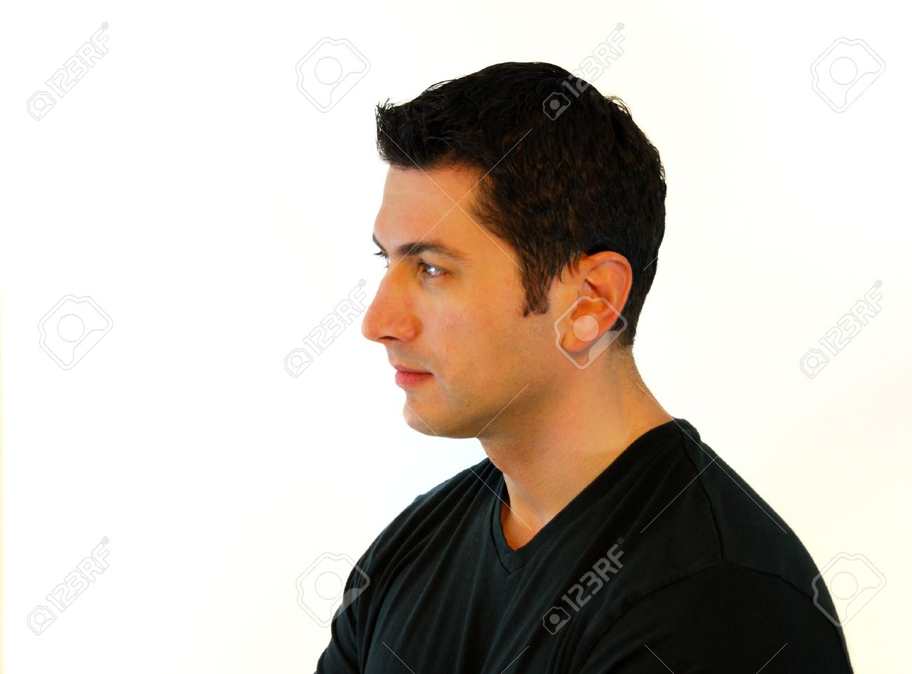 A profile of a pensive man in black t-shirt over white background. Stock Photo - 5671064