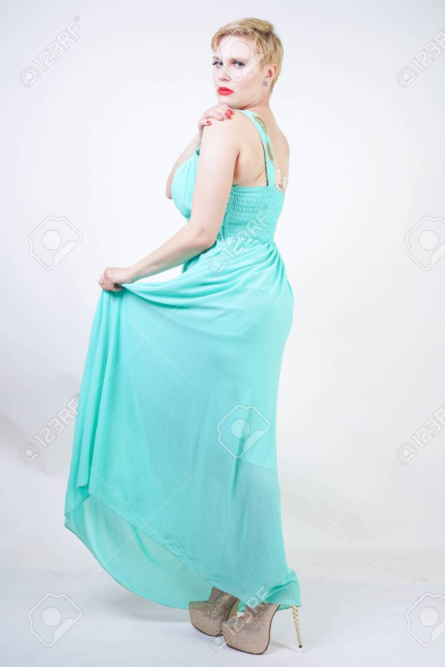 curvy plus size woman in long mint blue dress