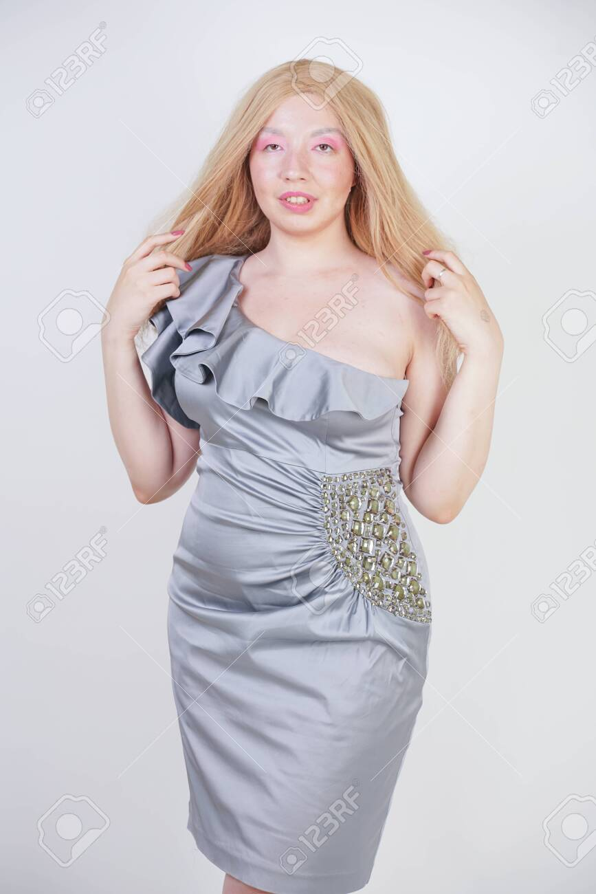 hot fashionable blonde mix raced woman in trendy party dress..