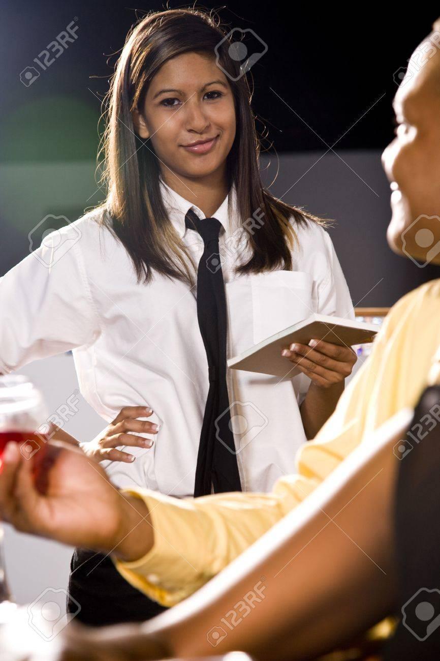 Hispanic waitress taking a customer's order Stock Photo - 6178881