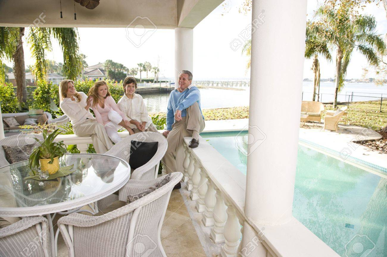 Portrait of family on vacation relaxing on terrace together Stock Photo - 6328979
