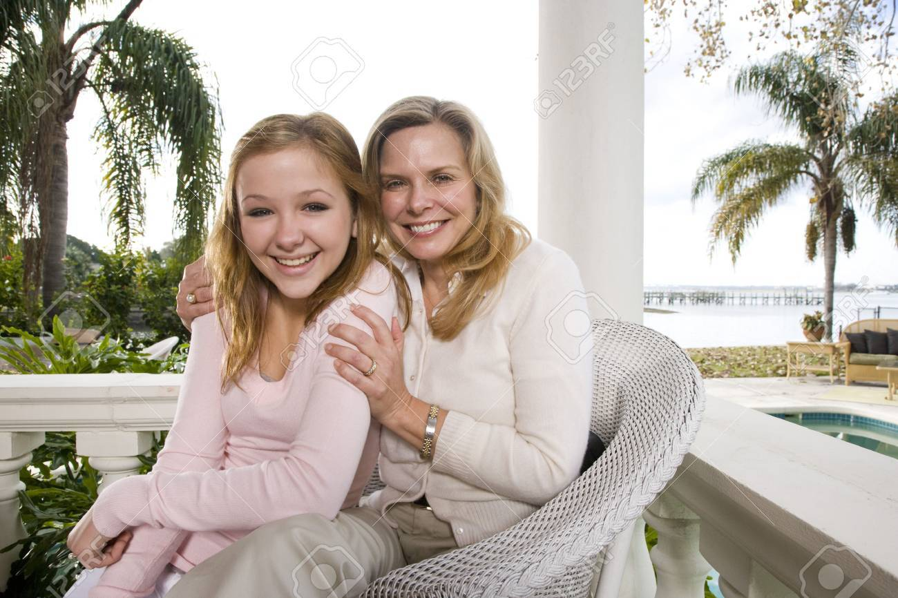 Portrait of mother and daughter on waterfront terrace Stock Photo - 6329034