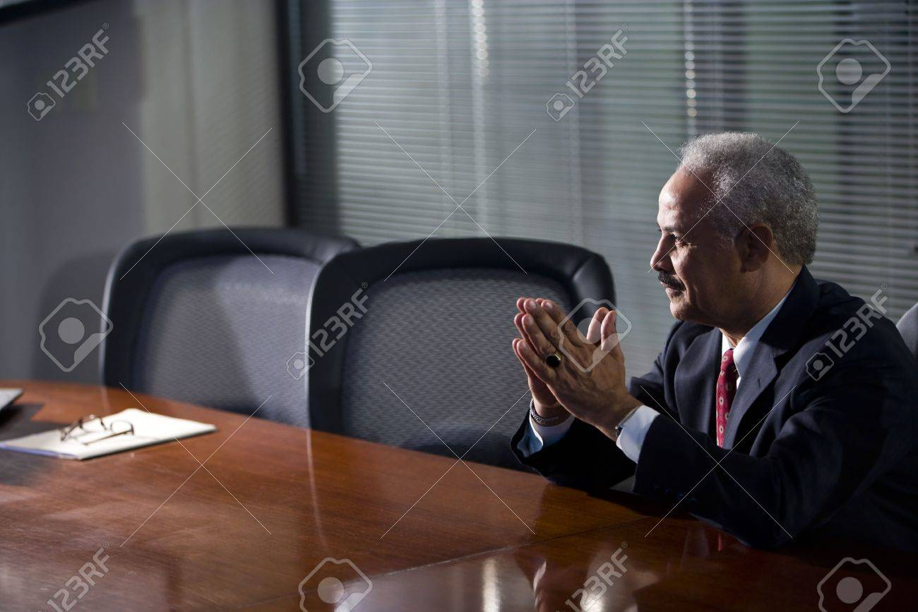 Mature African American businessman sitting at conference table Stock Photo - 6375556