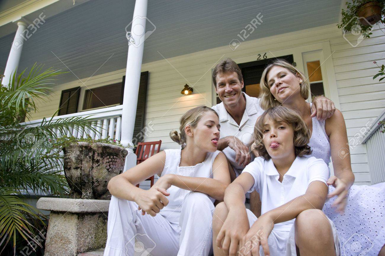 Family sitting together on front porch steps Stock Photo - 6610714