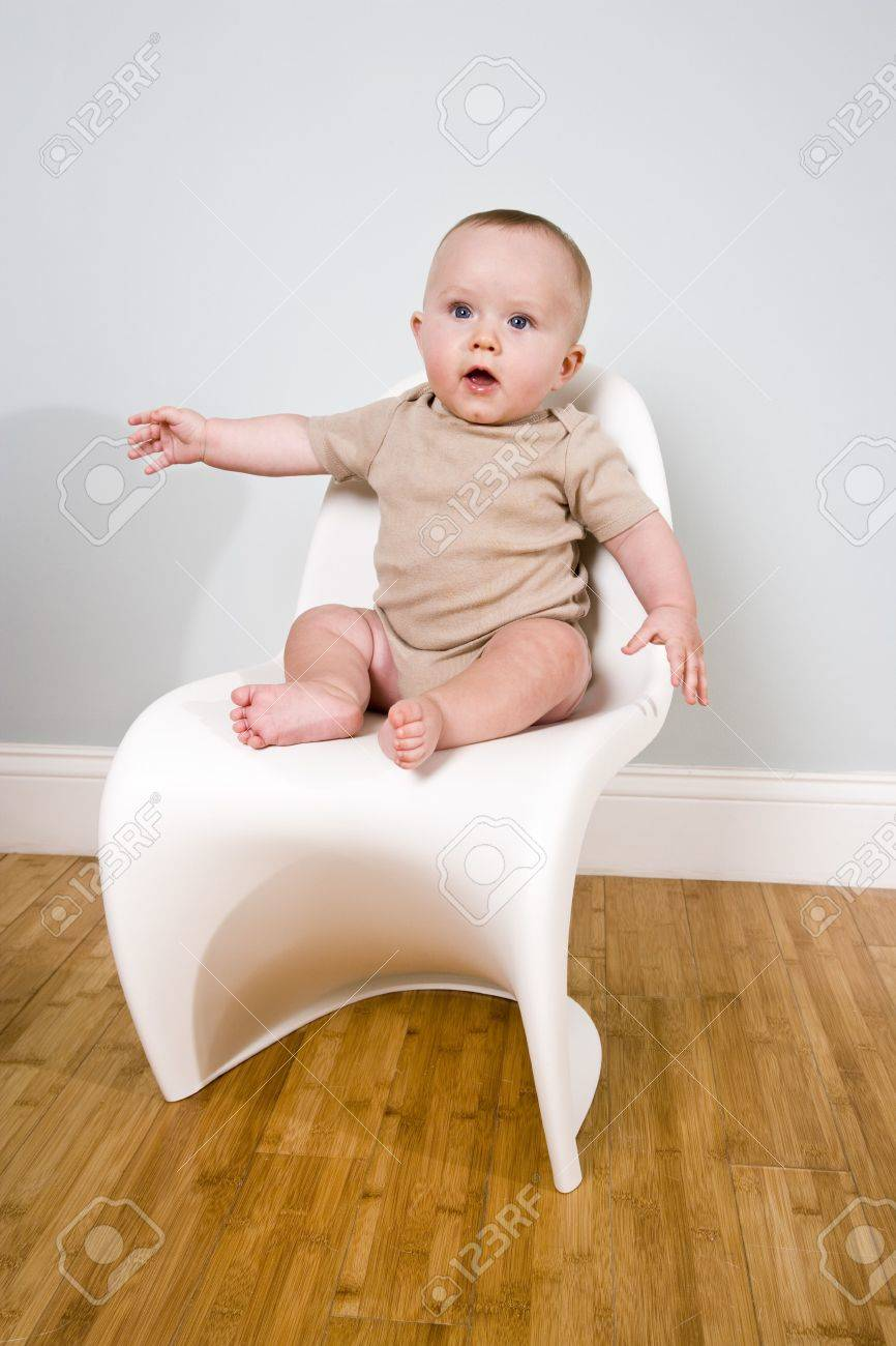 Six month old baby sitting on a chair Stock Photo - 6644296