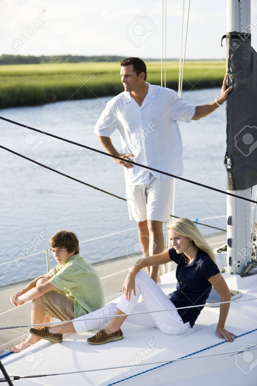 Family vacation together on sailboat on sunny day, on Florida intracoastal waterway Stock Photo - 6865111
