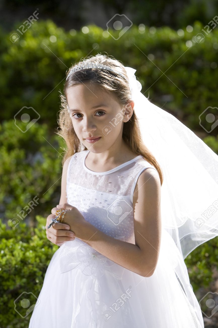 Beautiful 8 Year Old Girl In White Dress Standing In Sunlight ...