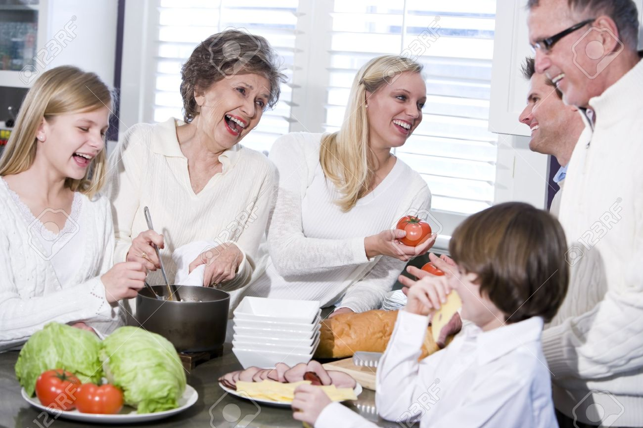 Family cooking kitchen - Grandmother With Family Cooking In Kitchen Smiling And Laughing Together Stock Photo 7181752