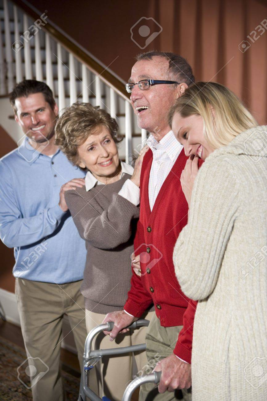 Happy senior man with walker at home with family Stock Photo - 7095863