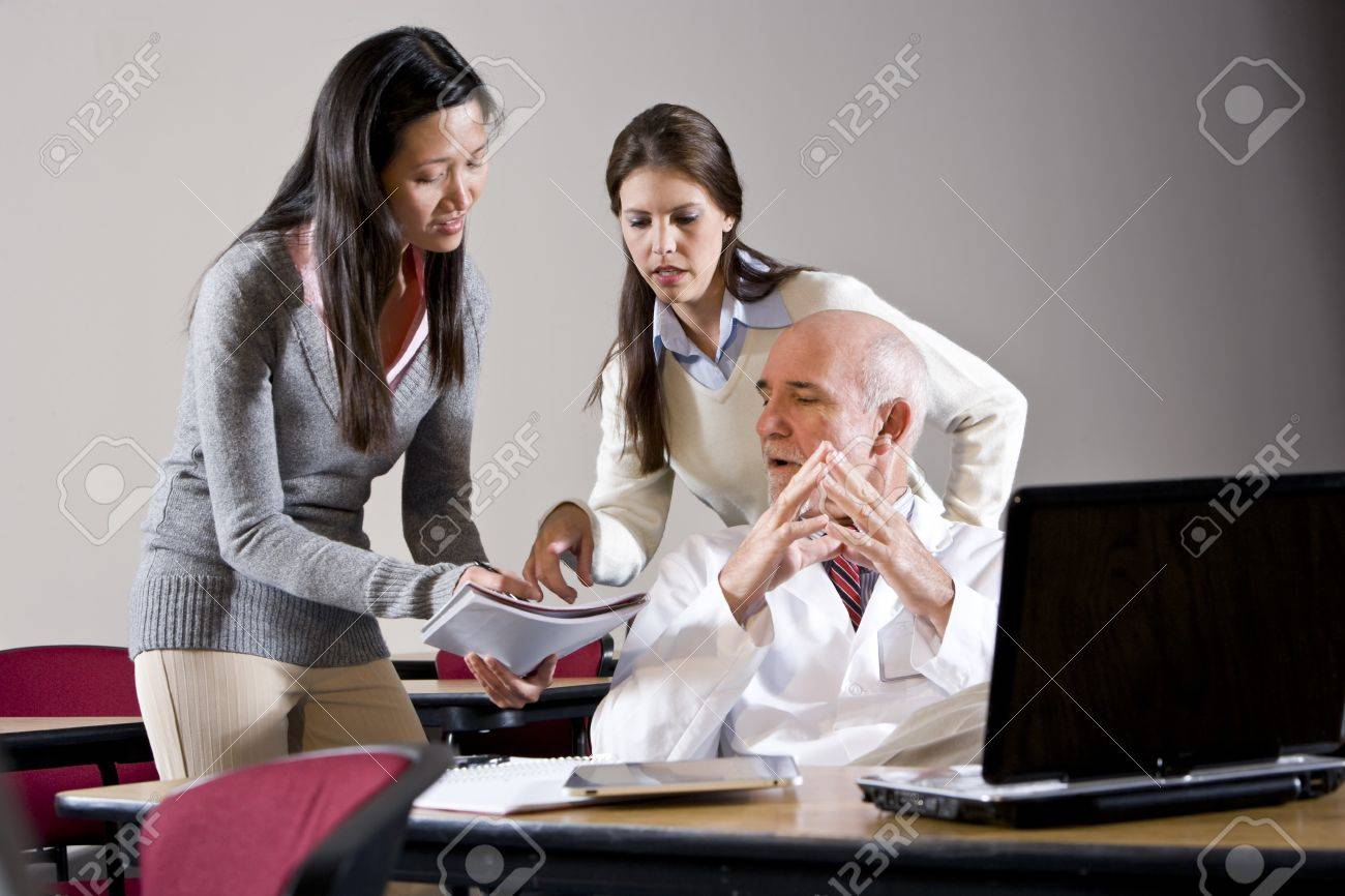 Scientist in lab coat talking to assistants in conference room Stock Photo - 7159202