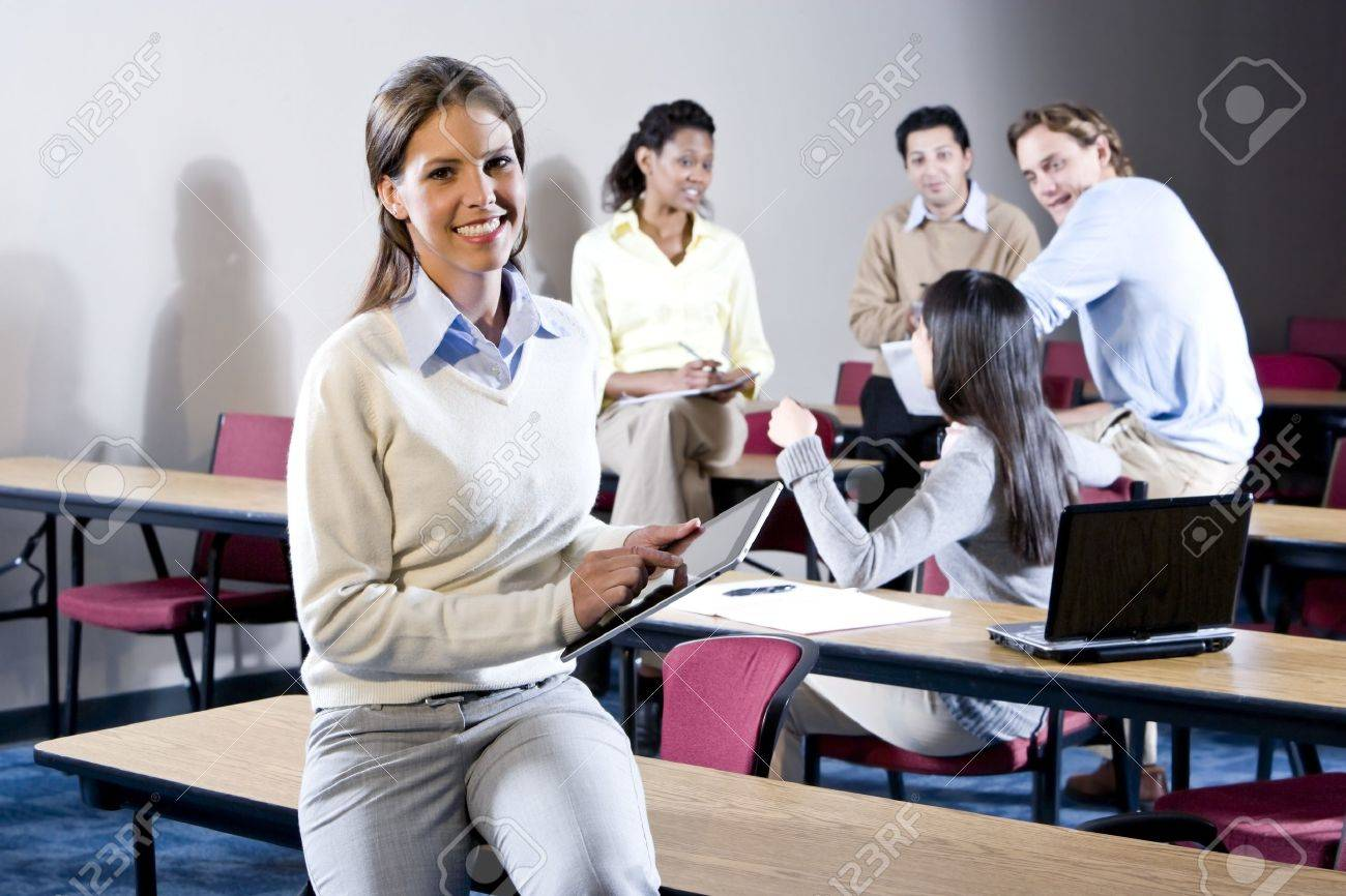 College students in classroom talking, focus on woman in foreground Stock Photo - 7159208