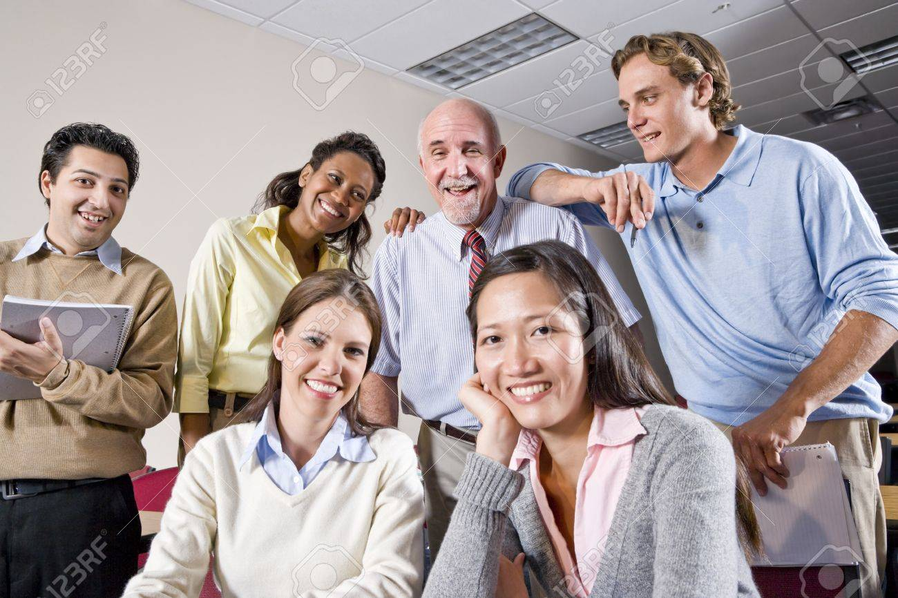 Multiracial group of college students and teacher in class Stock Photo - 7159245