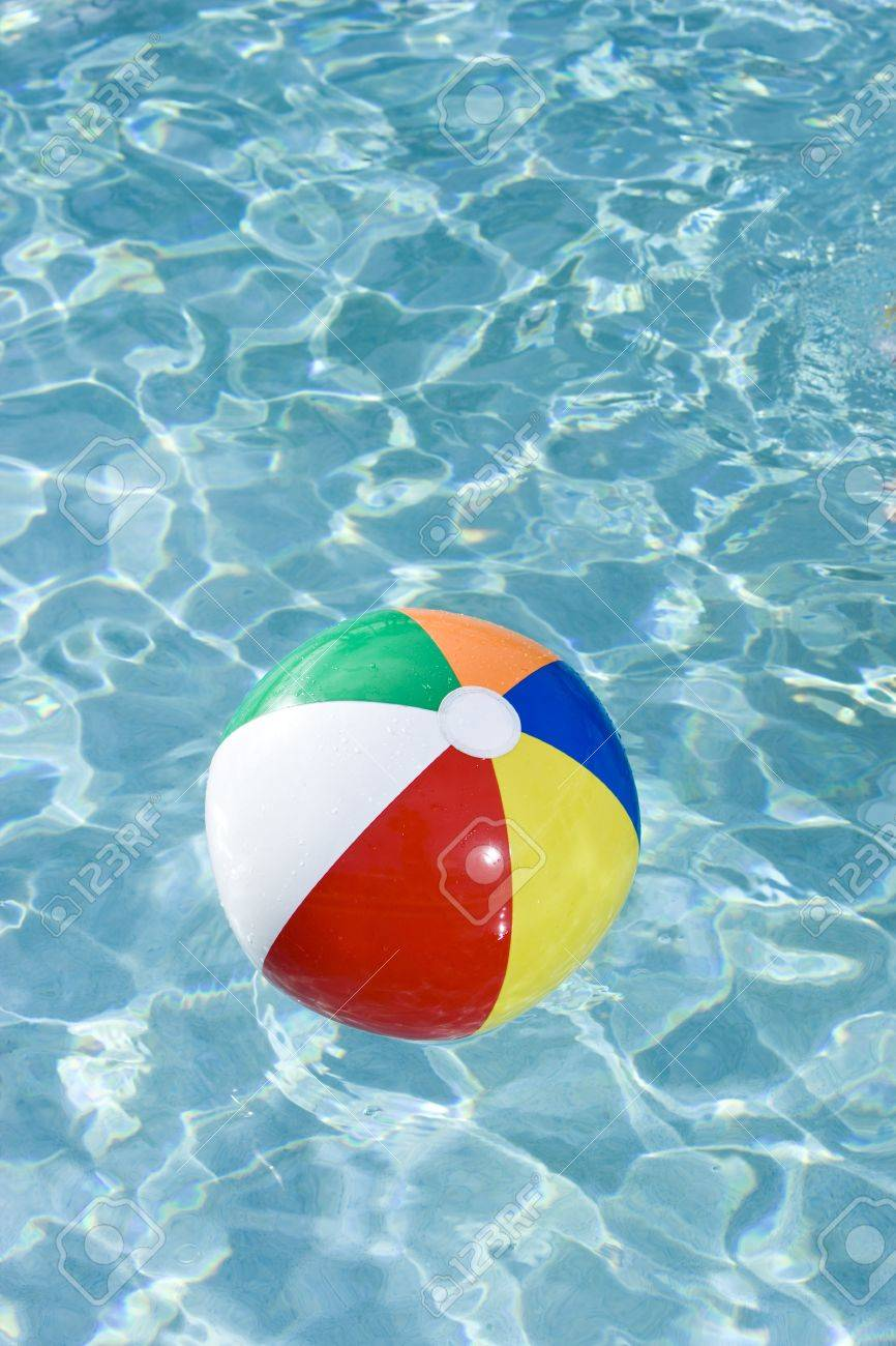 Pool Water With Beach Ball colorful beach ball floating on surface of swimming pool water