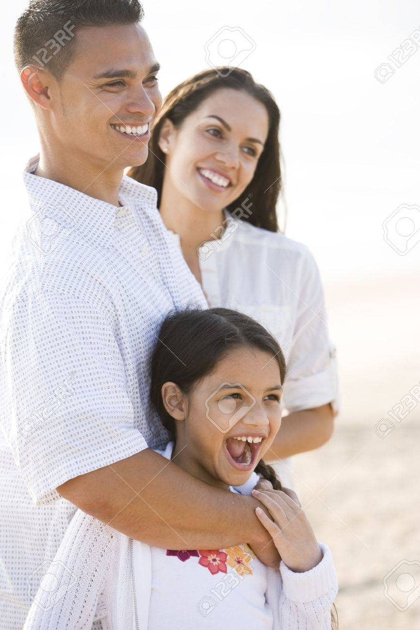 Portrait of happy Hispanic family with young 9 year old daughter laughing Stock Photo - 7219892