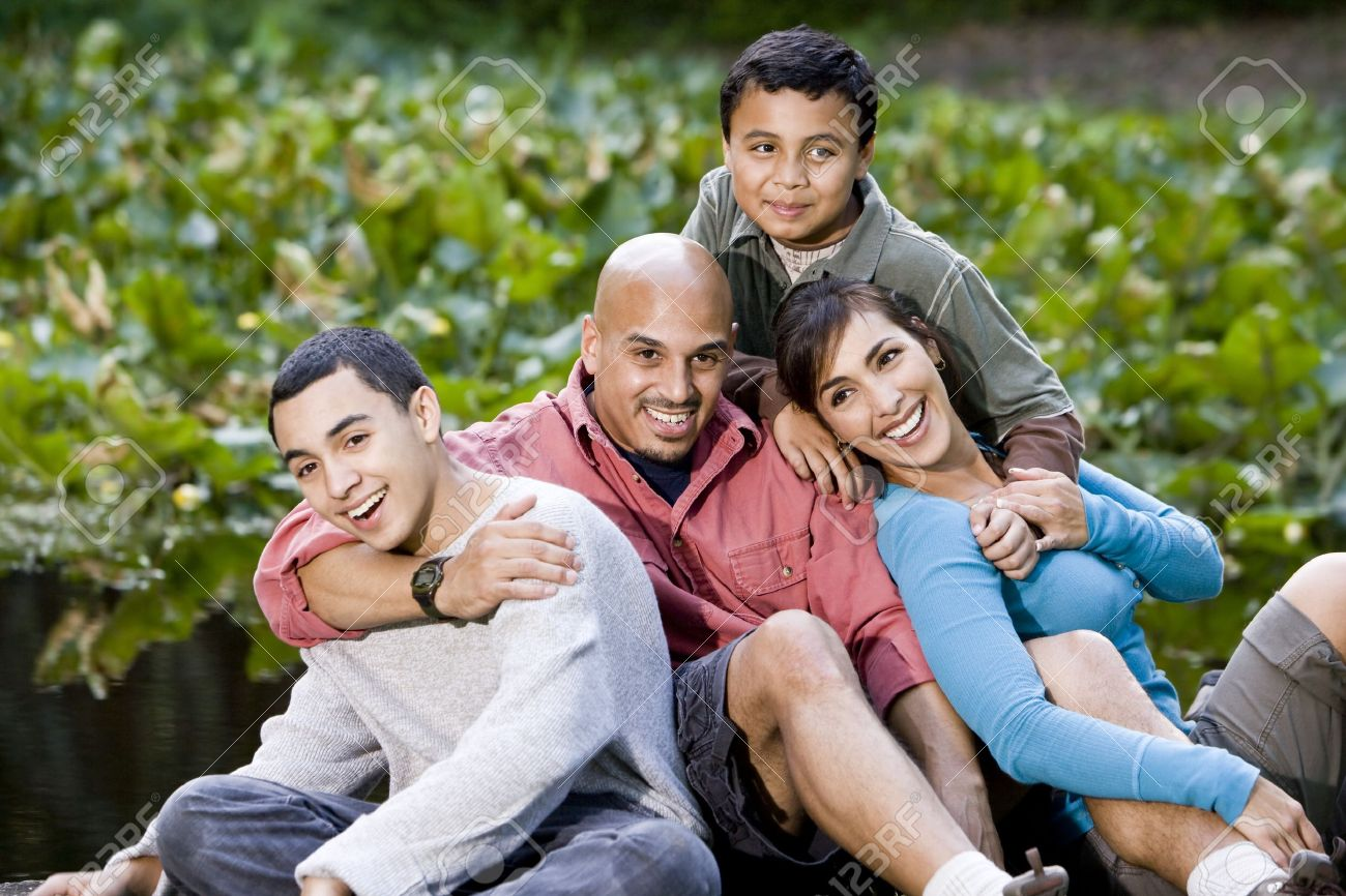 Portrait of happy Hispanic family with two boys outdoors Stock Photo - 7319102