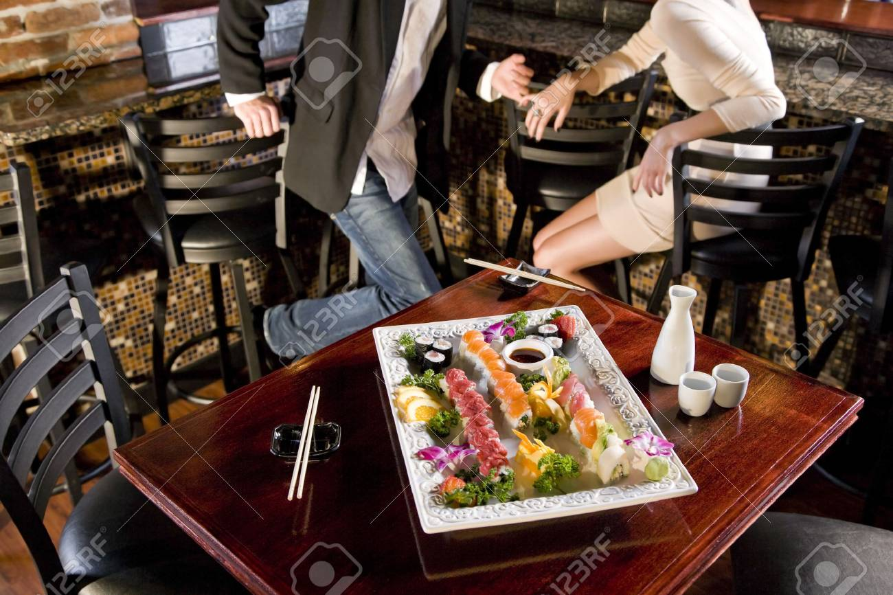 Platter Of Sushi On Table In Japanese Restaurant Couple At Bar Stock Photo Picture And Royalty Free Image Image 7420906