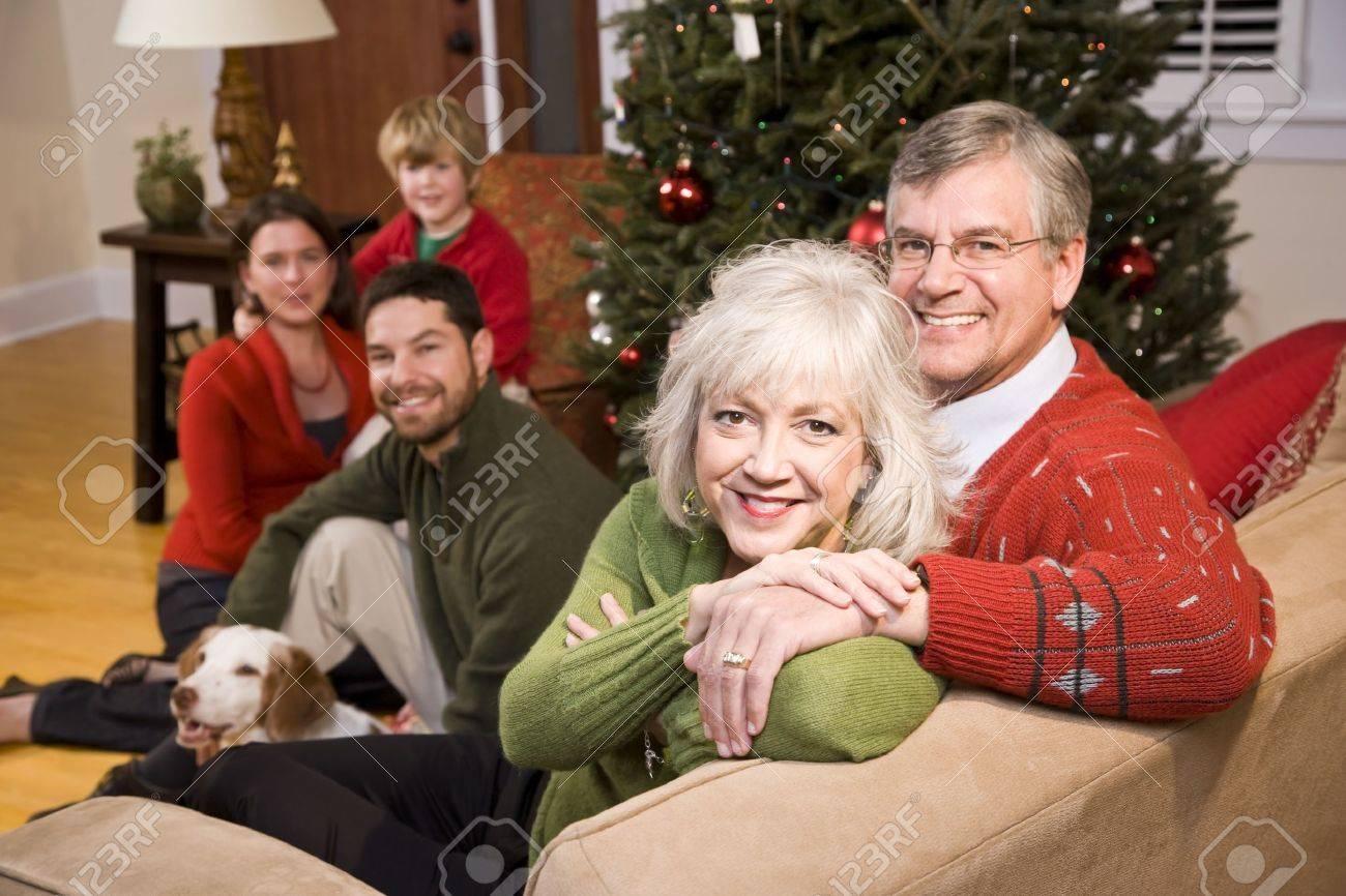 Senior couple with family by Christmas tree - three generations Stock Photo - 7635034