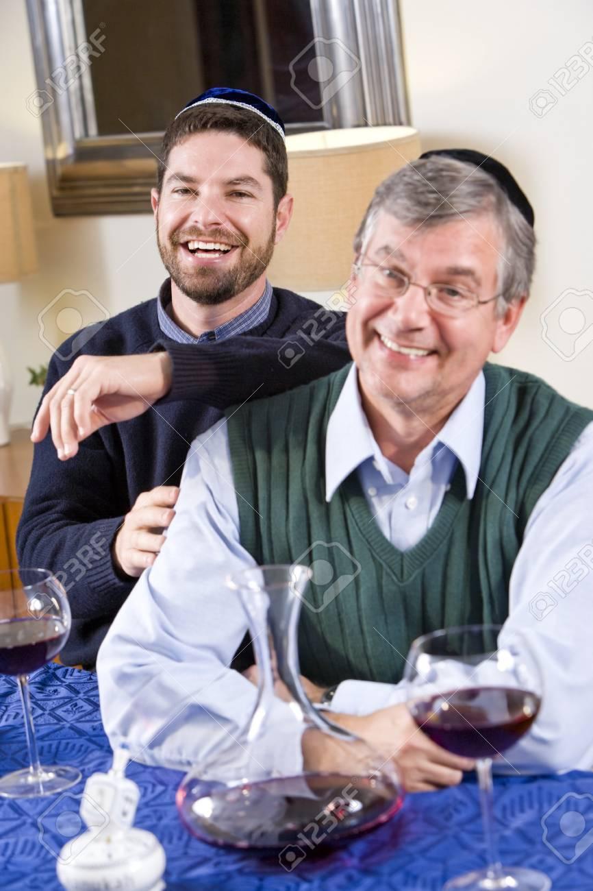 Senior Jewish man and adult son celebrating Hanukkah Stock Photo - 7634847