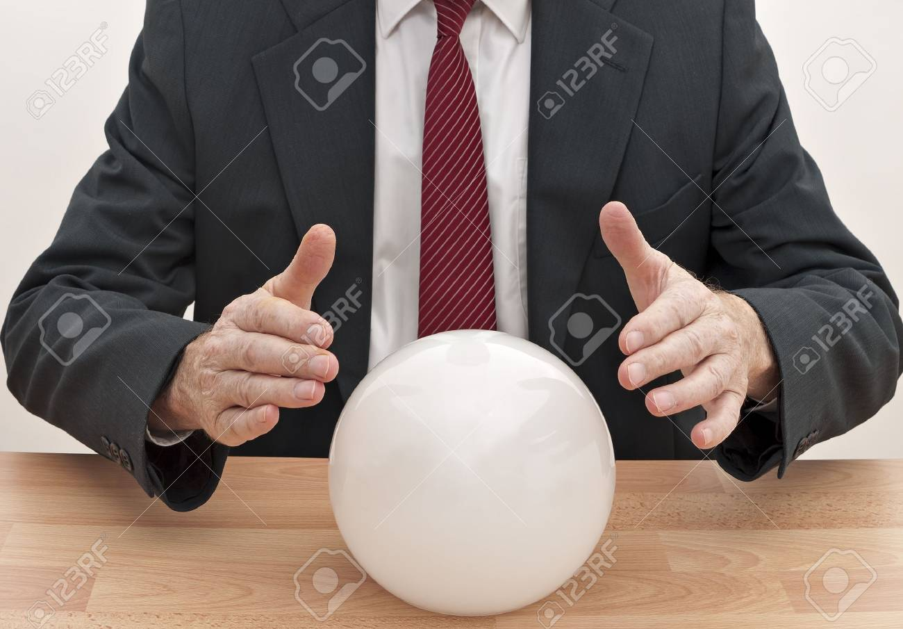 Businessman with crystal ball - concept Stock Photo - 11938398
