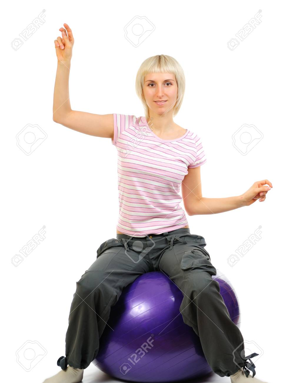 Girl on blue ball isolated on white background Stock Photo - 6110925
