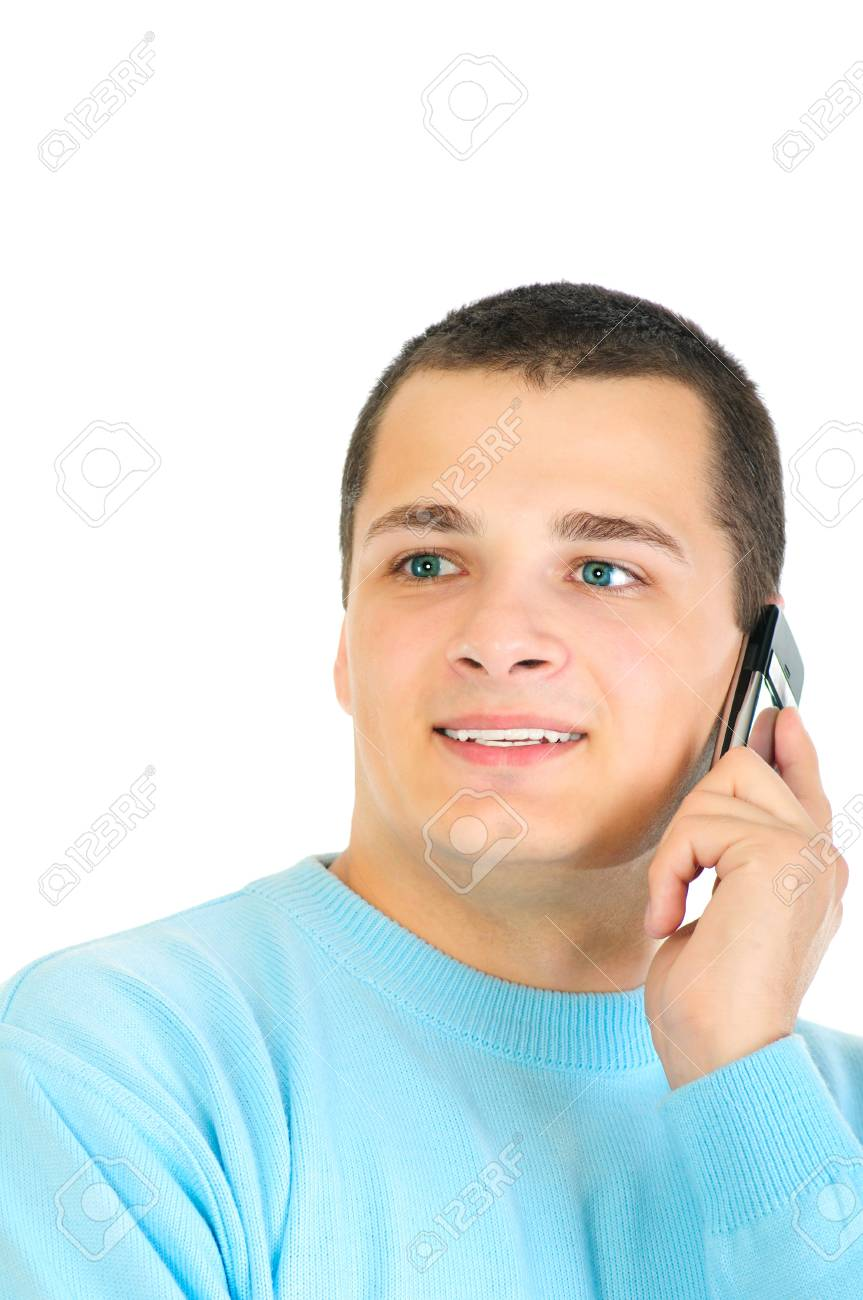 Casual man smiling and talking on a mobile phone isolated on white background Stock Photo - 8076926