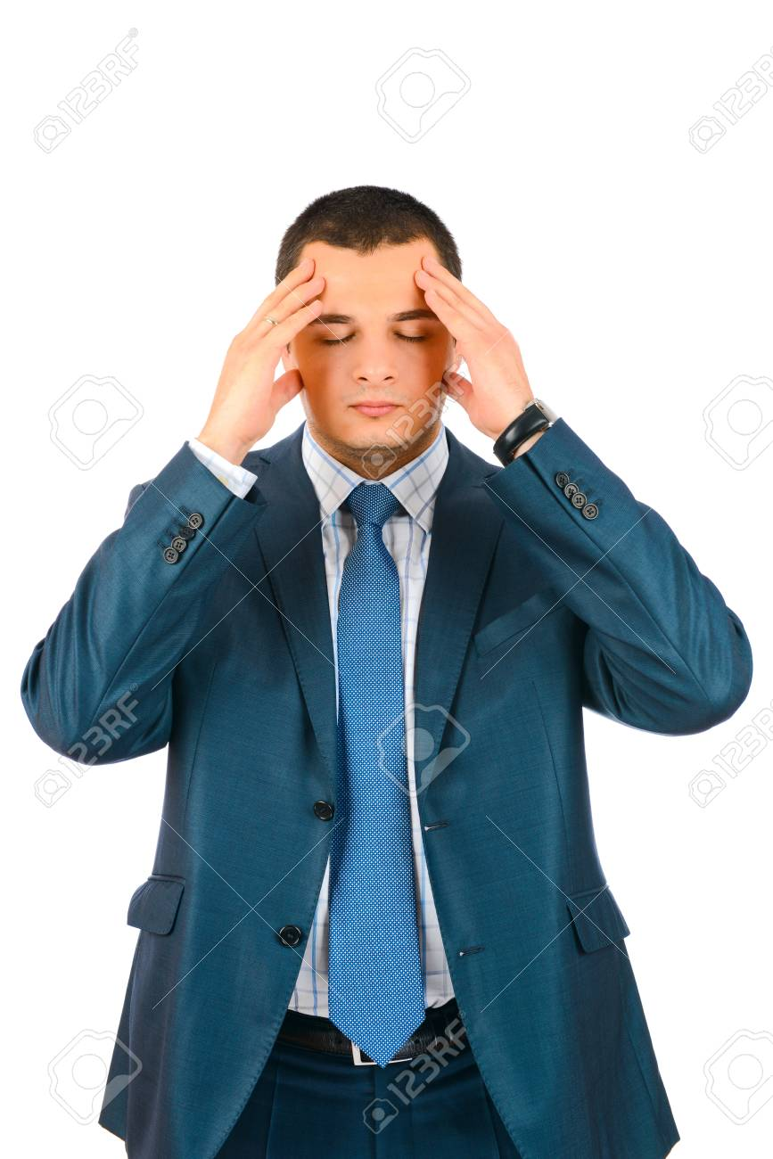 Closeup of young business man with headache rubbing temples Stock Photo - 17099052