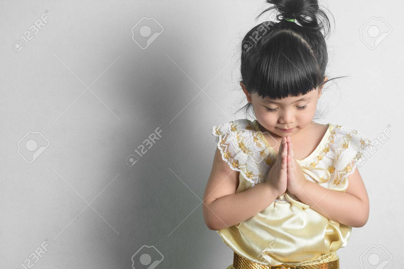 Cute Thai Girl In Thai Dress Costume In A Welcome Pose Hello
