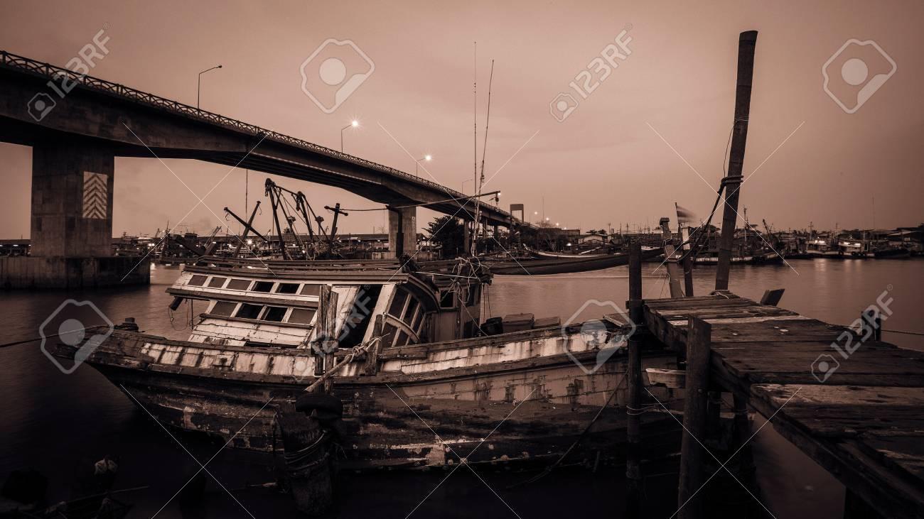 Fishing Boat park near the Bridge Stock Photo - 17233253