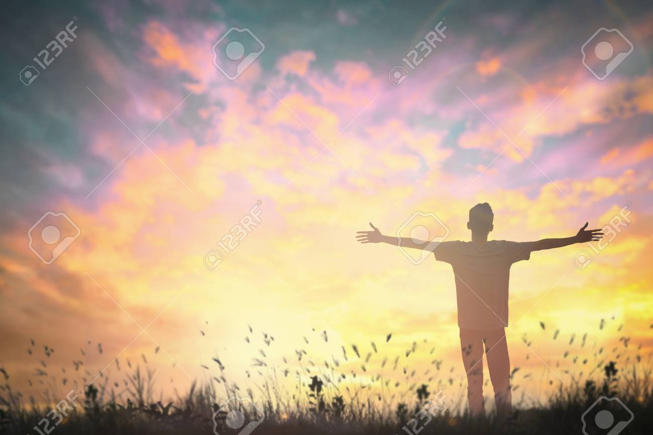 Happy man rise hand on morning view  Christian inspire praise