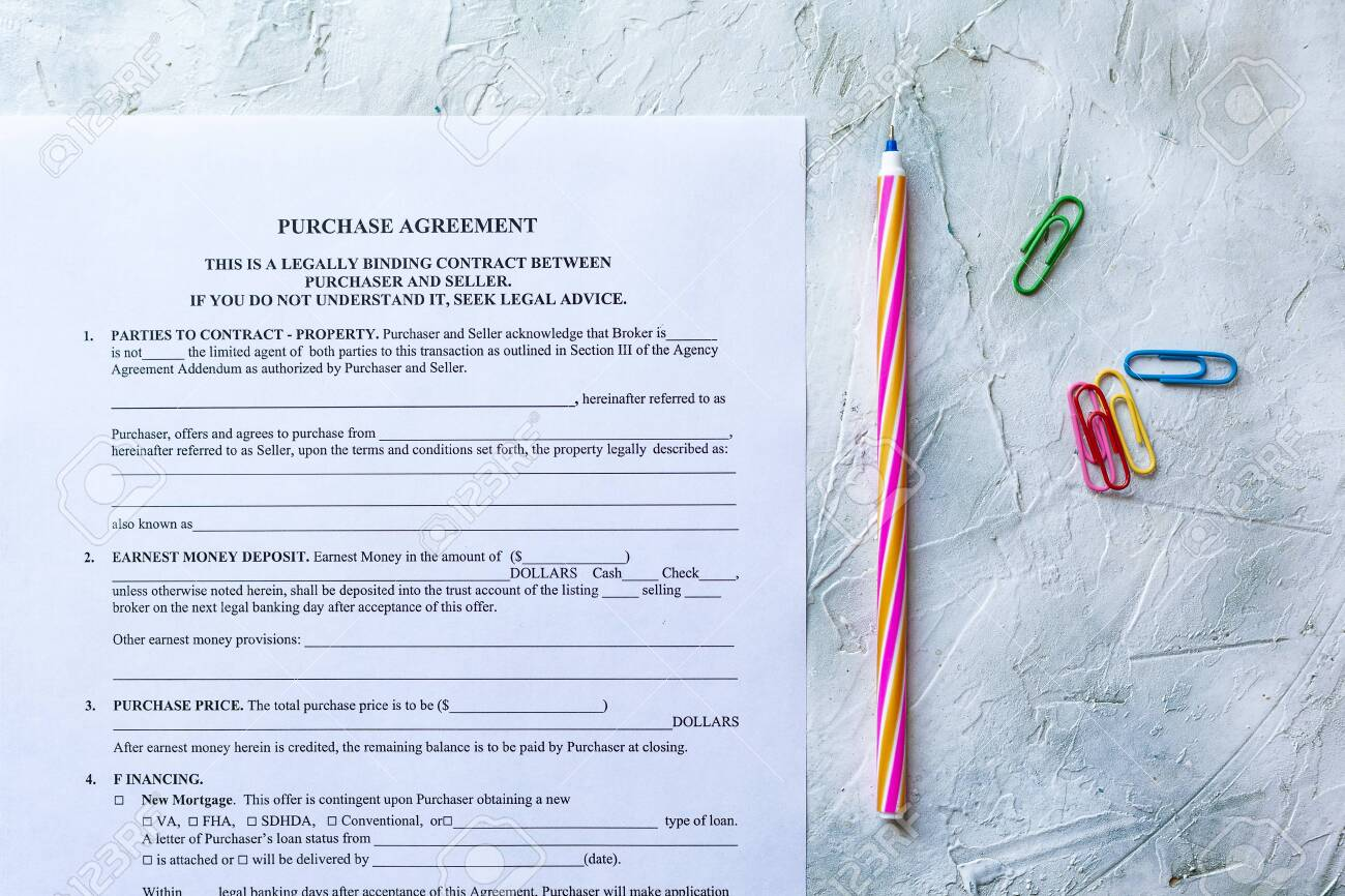 Filling Blank Purchase Agreement Form View From Above