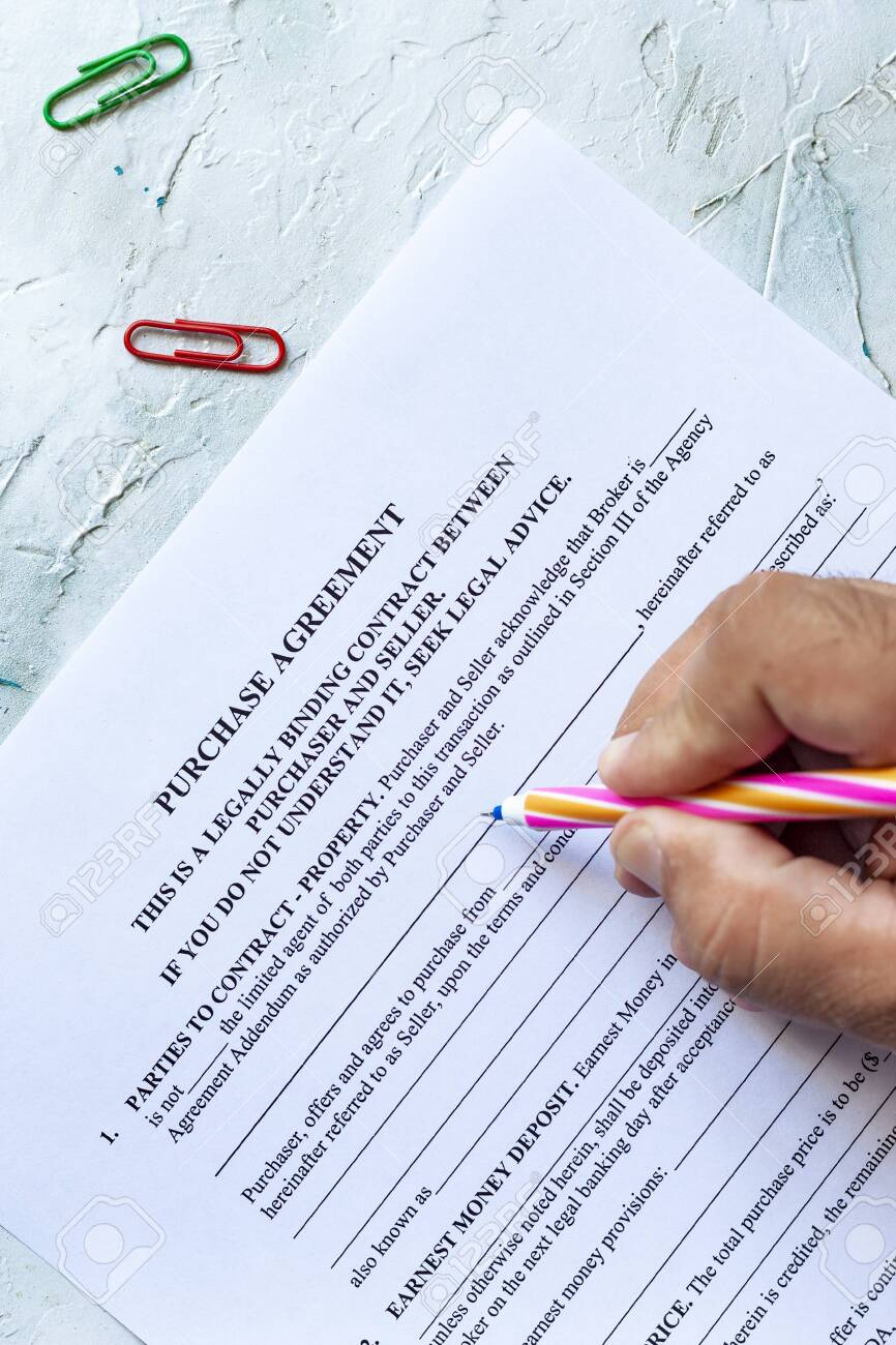 Person Filling Blank Purchase Agreement Form View From Above Stock Photo Picture And Royalty Free Image Image 127742443