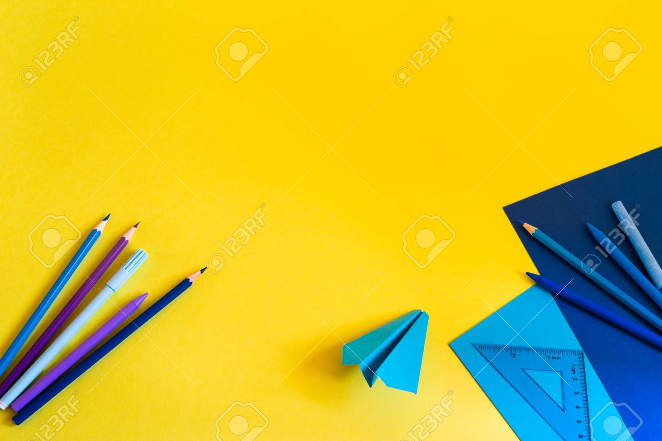 Creative, Fashionable, Minimalistic, School Or Office Workspace With Blue  Supplies On Yellow Background