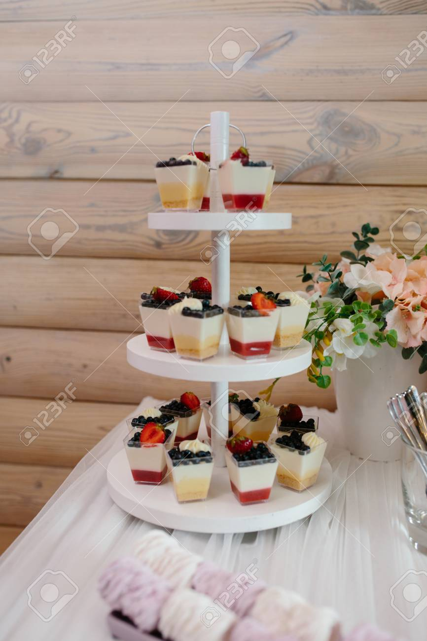 Candy Bar Decorated With Sweets Cupcakes And Cake For Birthday