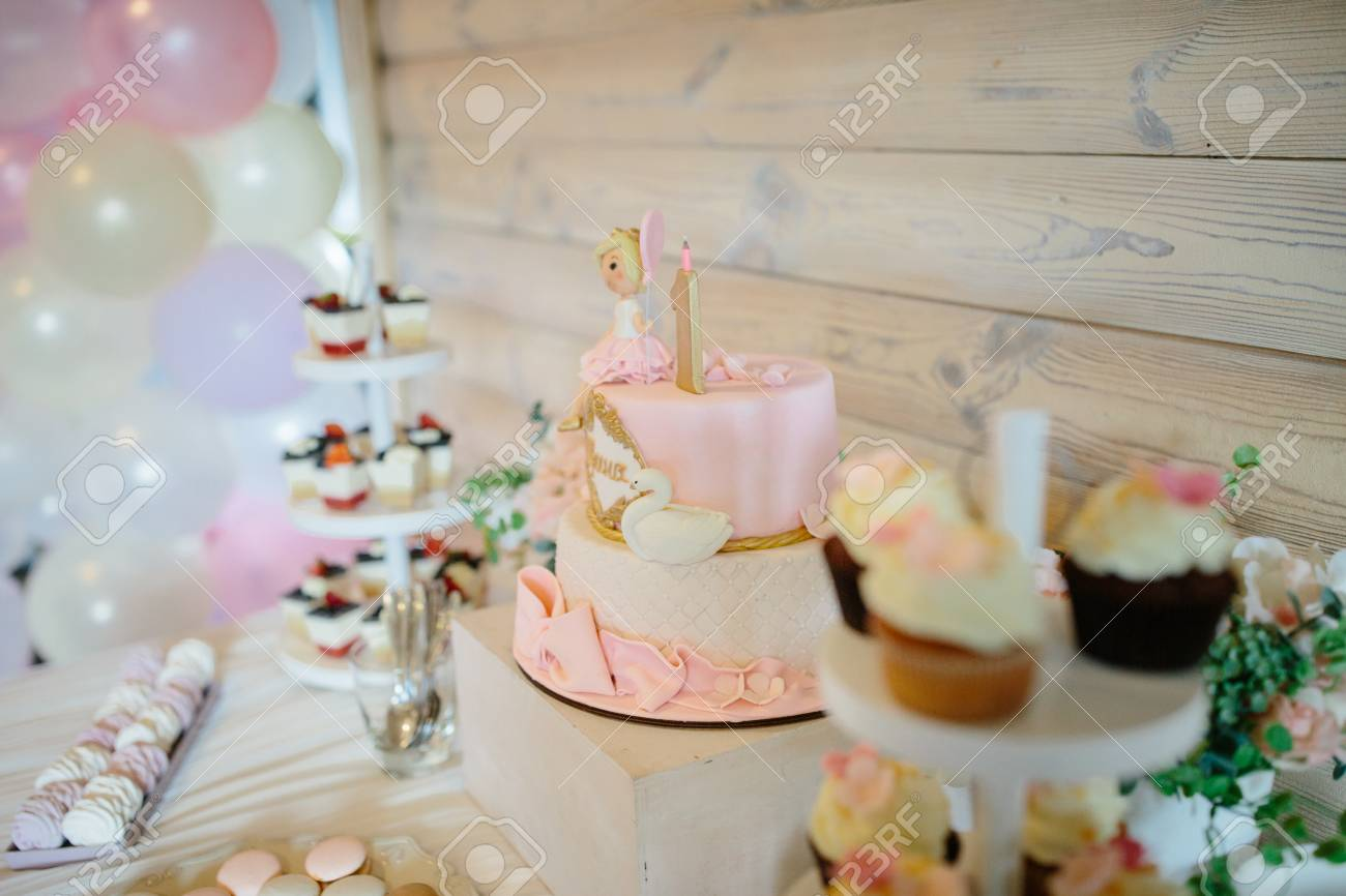 Candy Bar Decorated With Sweets Cupcakes And Cake For 1st Birthday