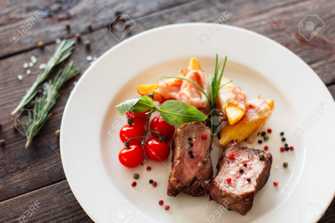 Medium Rare Pork Steak With Fresh Vegetables On White Plate Stock Photo Picture And Royalty Free Image Image 56482291