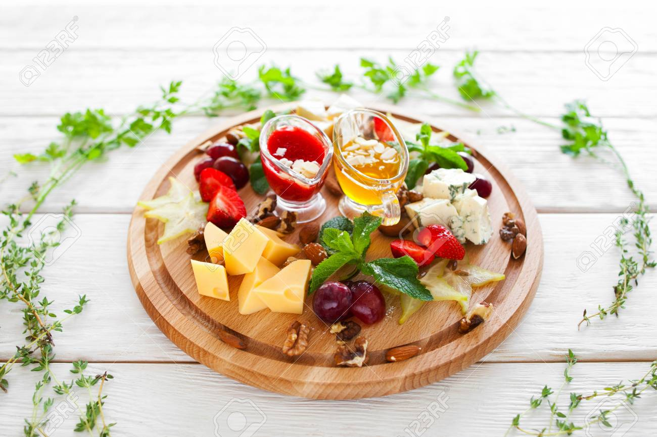 Plate With Snacks For Wine In Herbal Frame On White Top View Stock Photo Picture And Royalty Free Image Image 58961668