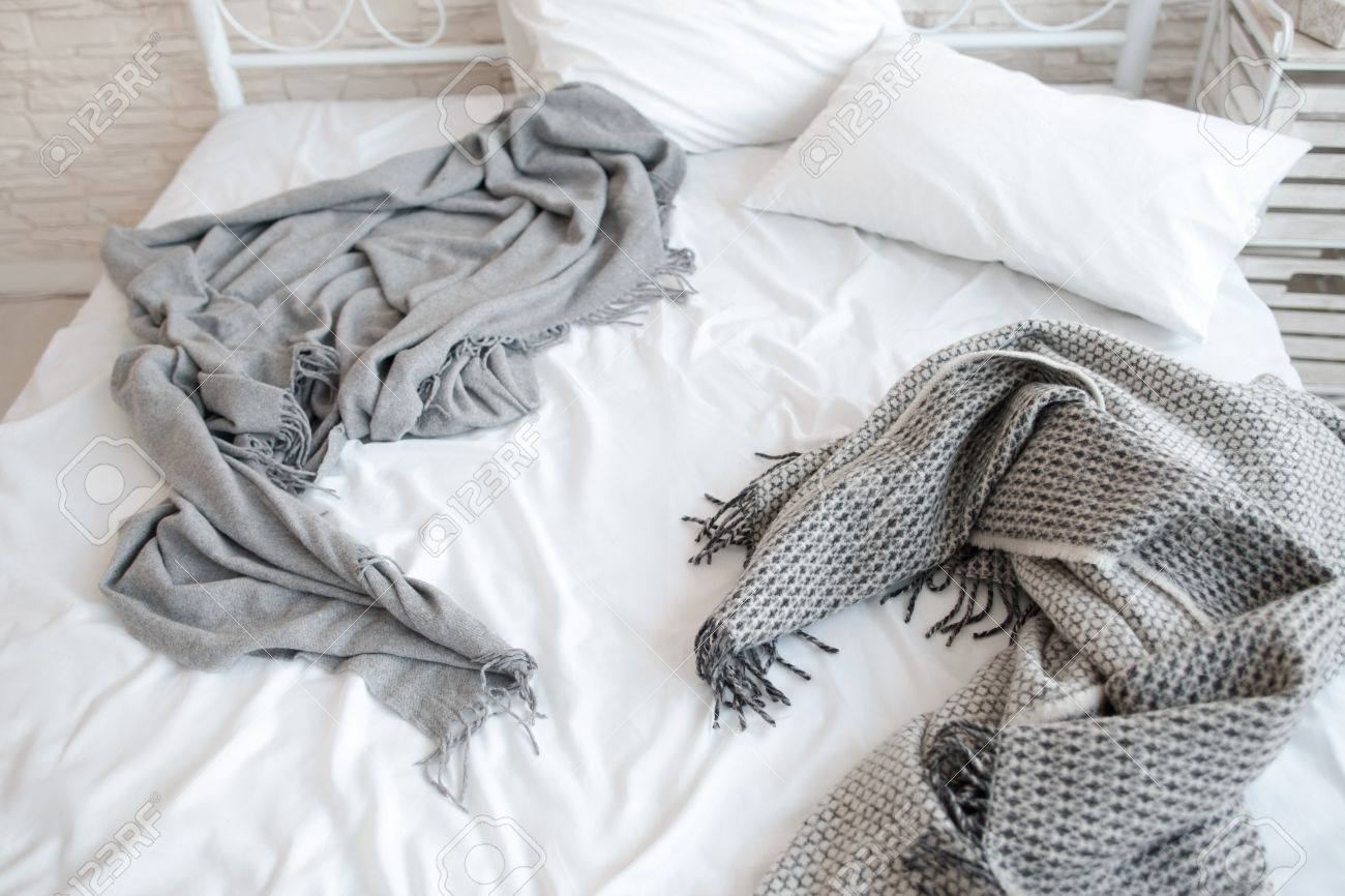 Stock Photo   Unmade Messy Bed With Wrinkled Sheets And Blankets. Top View  On Bed In The Morning After Awakening. Unmade Bed With White Pillows And  Gray ...