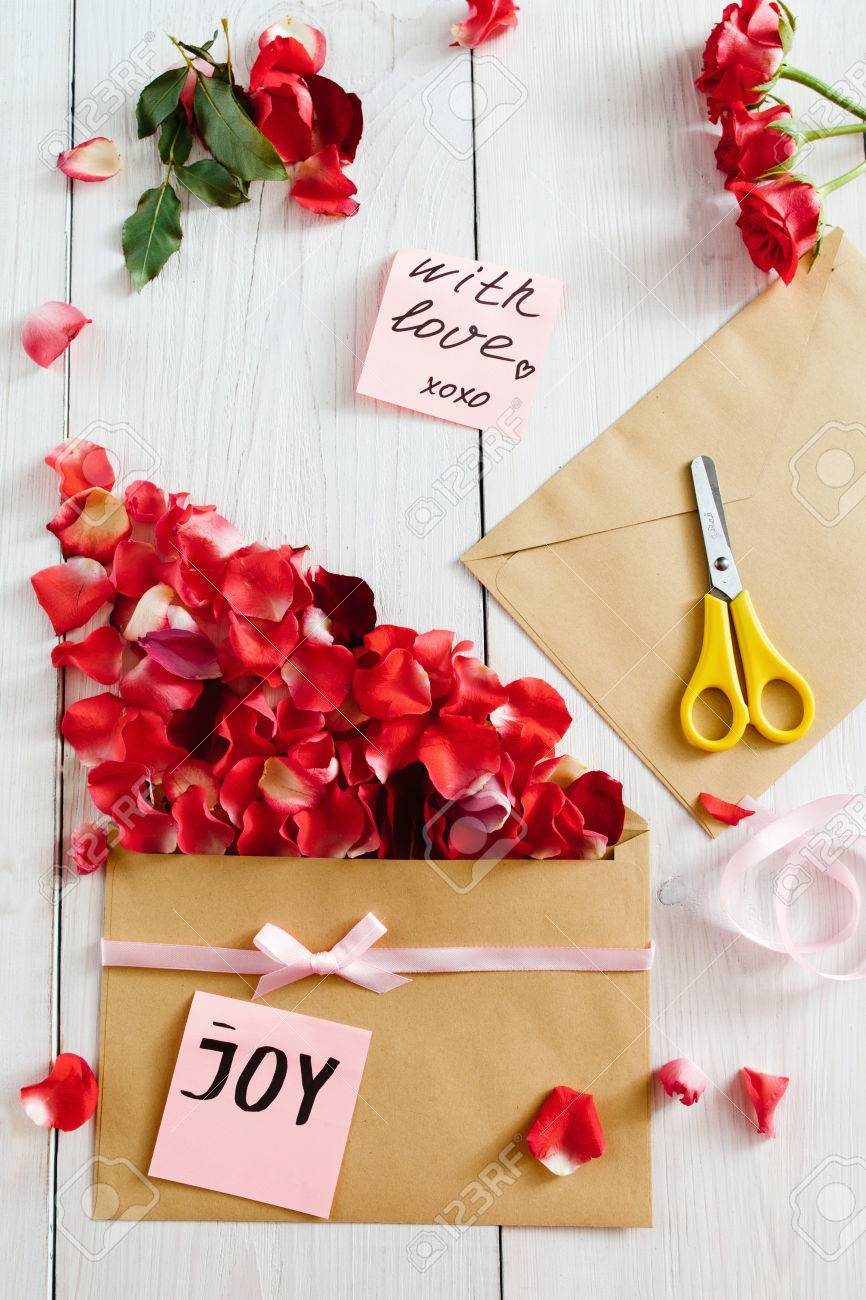 Making Love Message With Envelope And Rose Petals Flat Lay Stock