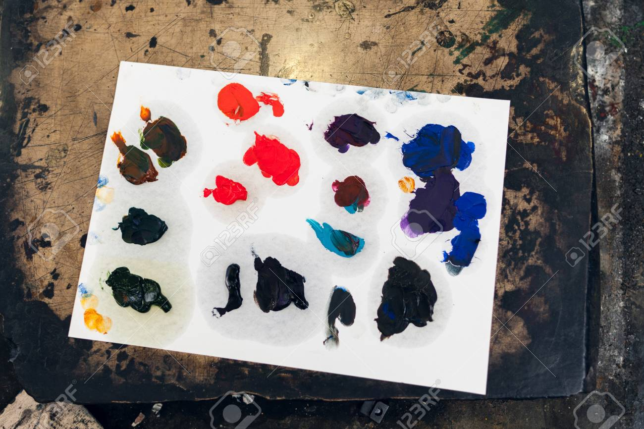 paper palette with different color smears painters pallet with