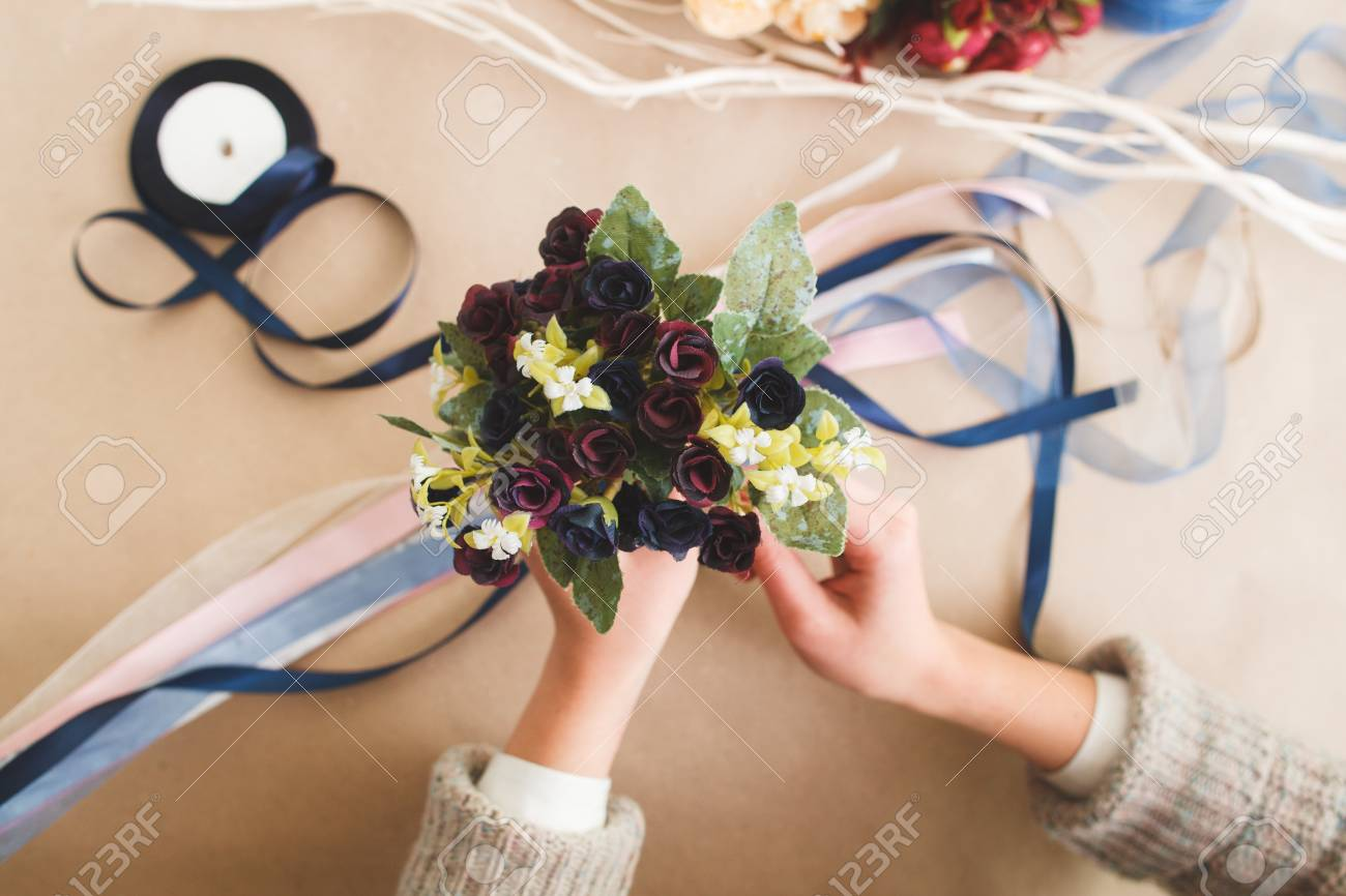 Unrecognizable woman hold creative colorful bouquet from artificial stock photo unrecognizable woman hold creative colorful bouquet from artificial flowers flat lay making beautiful decorations handmade art izmirmasajfo