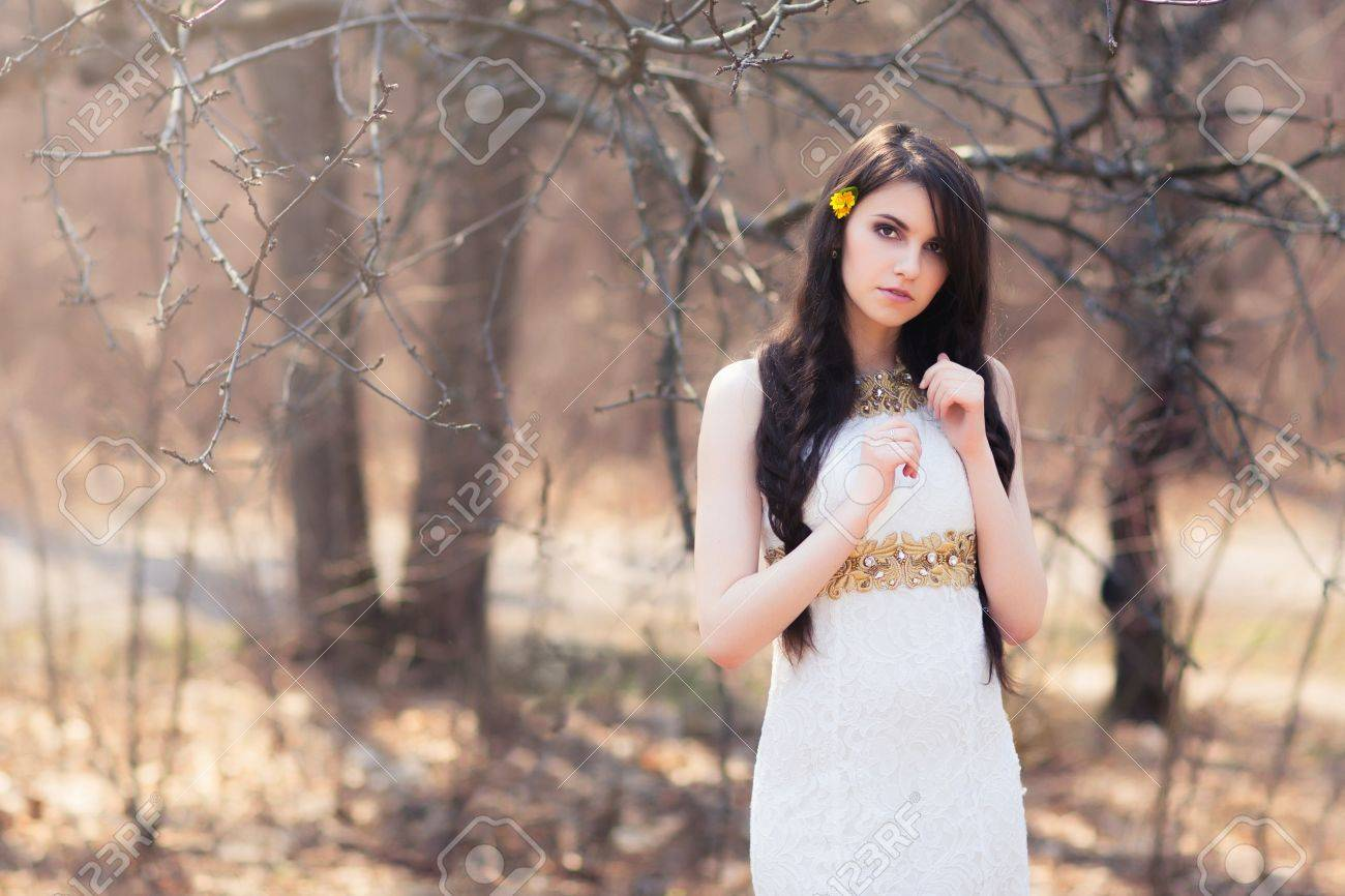 Young beautiful woman with flowers in hair braided bride at stock stock photo young beautiful woman with flowers in hair braided bride at forest in white dress on blurred autumn background during a wedding photo shoot izmirmasajfo