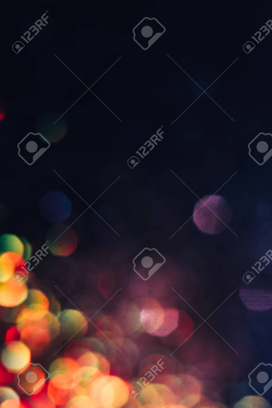 Abstract blurred light background, colorful lens flare. Glitter in bokeh. Christmas wallpaper decorations concept. New year holiday festive backdrop. Sparkle circle celebrations display. - 82682356