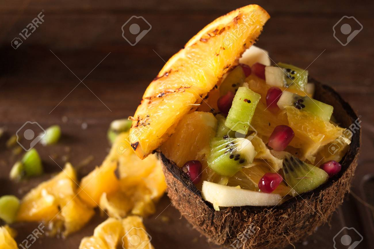 Exotic Tropical Fruit Salad Mixed In Coconut Shell Orange Apple