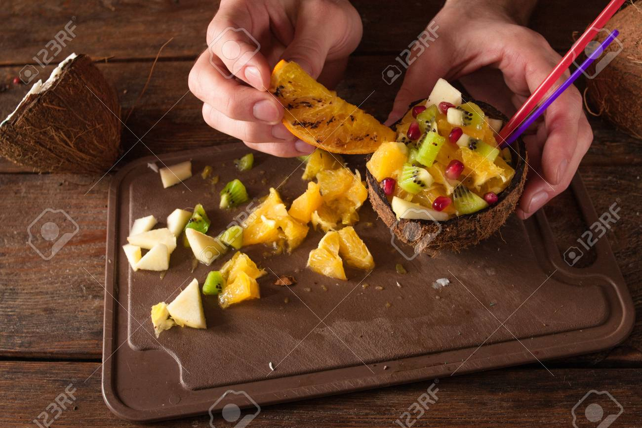 Decoration Of Tropical Fruit Salad In Coconut Shell Apple Orange